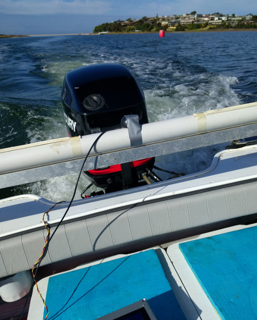 GPS Antenna taped to rod support at back of the boat